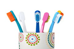 Tooth Brushes in ceramic cup Stock Images
