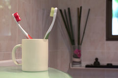Tooth brushes. Colourful toothbrushes on the bathroom Royalty Free Stock Photography
