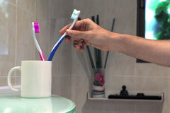 Tooth brushes. Colourful toothbrushes on the bathroom Royalty Free Stock Photo