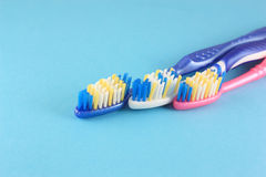 Tooth-brushes over blue Royalty Free Stock Photography