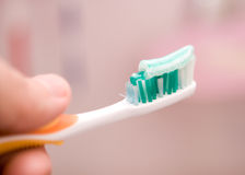 Tooth brushing. With tooth paste close up royalty free stock photos