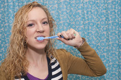 Tooth brushing girl Stock Photo