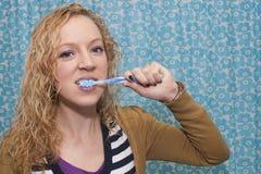 Tooth brushing girl Stock Photo