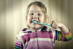 Tooth brushing girl Royalty Free Stock Photography