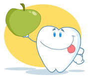 Tooth character holding up a green apple Royalty Free Stock Images
