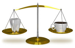 Tooth and coffee on scales Royalty Free Stock Photo