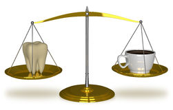 Tooth and coffee on scales Stock Images