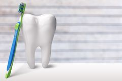 Tooth and dentist mirror stock image
