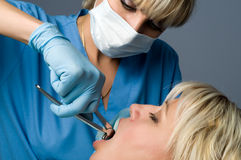 Tooth extraction. Using forceps, special dental instrument for teeth removal Royalty Free Stock Photo