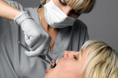Tooth extraction. Using forceps, special dental instrument for teeth removal Stock Photography