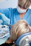Tooth extraction. Dentist at work, tooth extraction using forceps Royalty Free Stock Photo