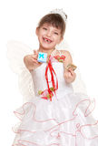 Tooth fairy girl dressed in white with wings give gift and money Stock Photography