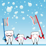 Tooth family. Colorful background with happy tooth family holding their toothbrushes with toothpaste. Mouth hygiene theme Stock Photo