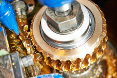 Tooth gear wheel machining Stock Photos