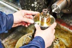 Tooth gear wheel machining Stock Photo