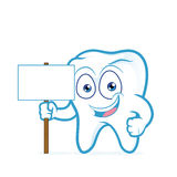 Tooth holding blank wood sign Royalty Free Stock Images