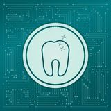 Tooth Icon on a green background, with arrows in different directions. It appears on the electronic board. Stock Photos