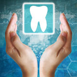 Tooth icon in hand. Medical background Royalty Free Stock Photography