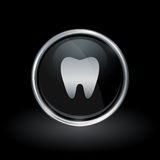 Tooth icon inside round silver and black emblem Stock Photos