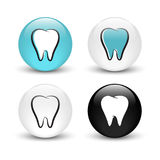 Tooth  glass buttons Stock Images
