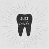 Tooth. Just smile. Vector. Black tooth on white background. Vintage retro sunburst, grunge background. Stock Image