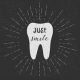 Tooth. Just smile. Vector. White tooth on black background. Vintage retro sunburst, grunge background. Stock Photo