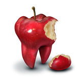 Tooth Loss Concept. As a red apple shaped as a human molar with a bite taken out of it as an icon for for human teeth health and oral hygiene or dentistry Stock Images