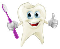 Tooth man holding a toothbrush Royalty Free Stock Photos