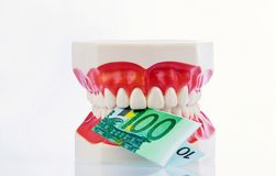 Tooth model with euro notes. A dental model to the dentist with euro notes. cost of health Royalty Free Stock Photos