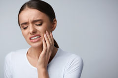 Tooth Pain. Beautiful Woman Feeling Strong Pain, Toothache. Tooth Pain And Dentistry. Beautiful Young Woman Suffering From Terrible Strong Teeth Pain, Touching royalty free stock photos