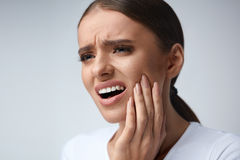 Tooth Pain. Beautiful Woman Feeling Strong Pain, Toothache Royalty Free Stock Photos
