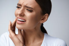 Tooth Pain. Beautiful Woman Feeling Strong Pain, Toothache. Tooth Pain And Dentistry. Beautiful Young Woman Suffering From Terrible Strong Teeth Pain, Touching Royalty Free Stock Photography