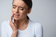 Tooth Pain. Beautiful Woman Feeling Strong Pain, Toothache. Tooth Pain And Dentistry. Beautiful Young Woman Suffering From Terrible Strong Teeth Pain, Touching Stock Image
