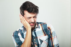 Tooth pain. Man have a horrible tooth pain suffer from illness royalty free stock image