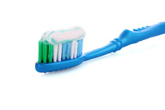 Tooth Paste on the blue  Brush Stock Photos