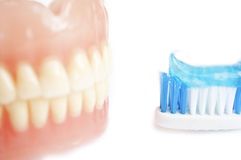 Tooth paste and denture Stock Photography