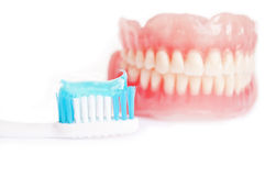 Tooth paste and denture Royalty Free Stock Image