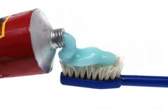 Tooth-paste and tooth-brush. It is isolated on a white background Royalty Free Stock Images