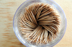 Tooth picks. Wooden tooth picks in a translucent plastic bottle Stock Photos