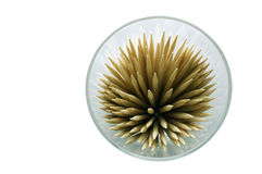 Tooth picks in shot glass. Tooth picks in a shot glass forming a pin cushion effect, isolated on white background Royalty Free Stock Image