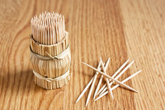 Tooth-picks on wooden table Royalty Free Stock Images