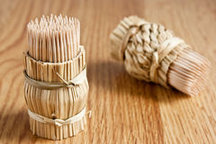 Tooth-picks on wooden table Stock Photo