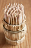 Tooth-picks on wooden table Stock Images