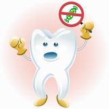 Tooth protesting against candies Stock Photography