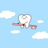 Tooth riding toothbrush into sky Stock Photography