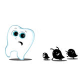 Tooth running away from monsters carious Stock Images