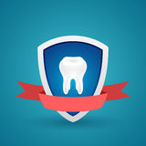 Tooth on the shield protected icon Stock Photos