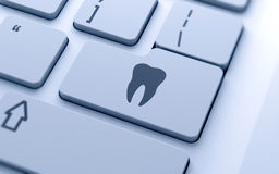 Tooth sign. Button on keyboard with soft focus Stock Photo