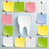 Tooth Stickers Thumbtacks. Tooth with sticks and thumbtacks on the gray background Royalty Free Stock Photos