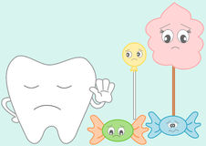 Tooth versus candies. Tooth versus sweet sad candies Royalty Free Stock Photography